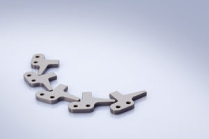 Chain cams for sheet metal working machines